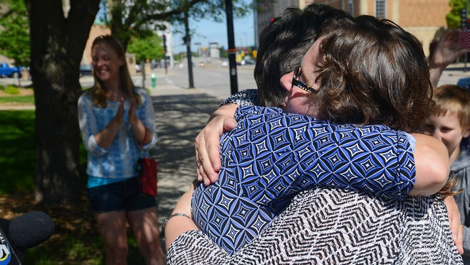 Stacie Christian, right, and Julie Tetzlaff celebrate their marriage after the Brown County clerk's office began issuing marriage licenses to same sex couples in June.