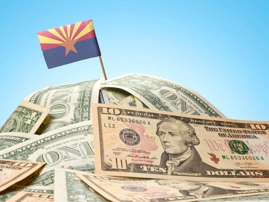 Flag of Arizona sticking in U.S. dollars
