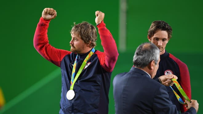 Aug 6, 2016: Brady Ellison (left) and Zach Garrett (middle) of the United States show off their medals in the medal ceremony at Sambodromo during the Rio 2016 Summer Olympic Games.