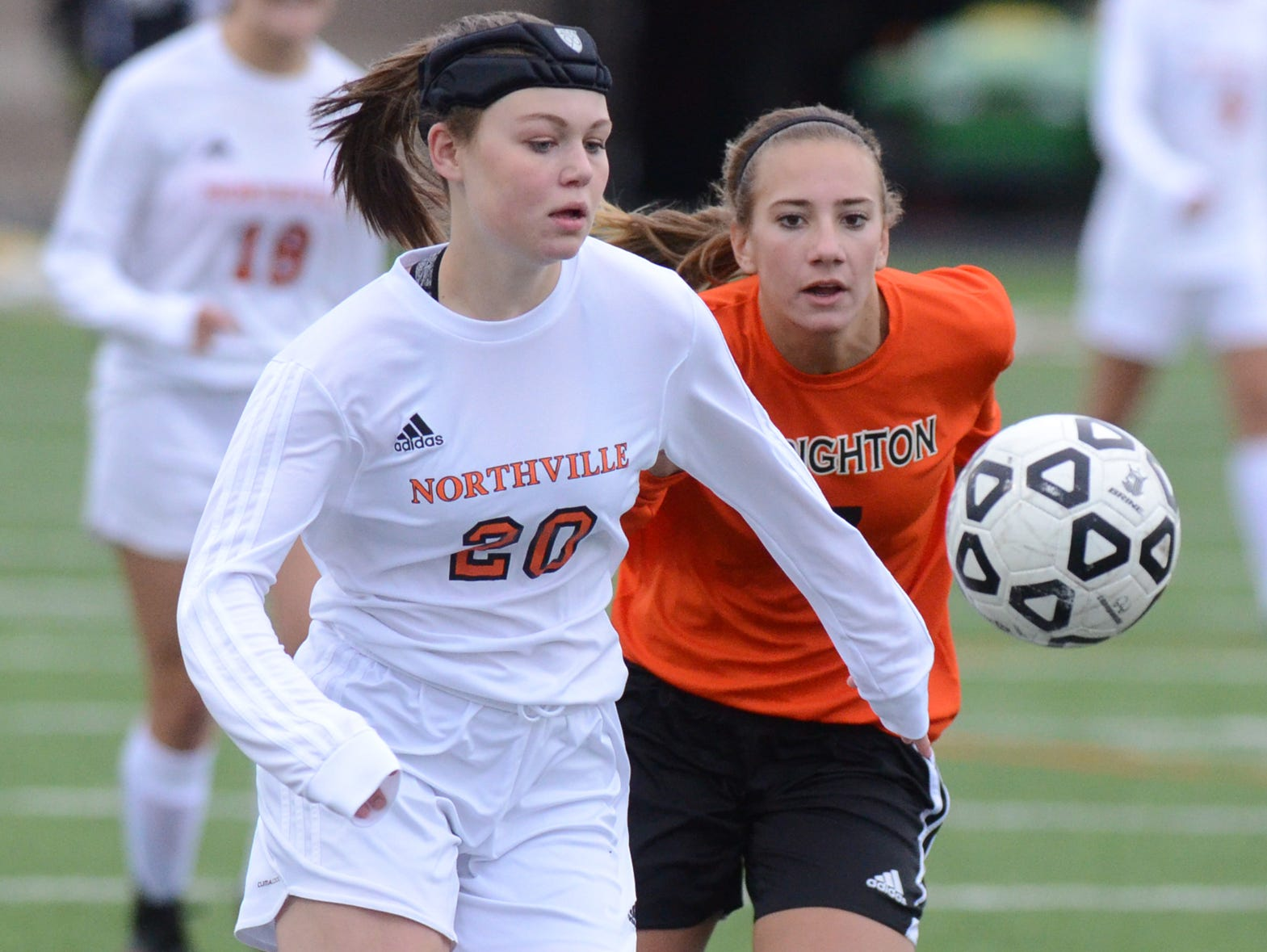 Northville's Nicole Skinner (left) cuts in front of a Brighton player to gain possession.