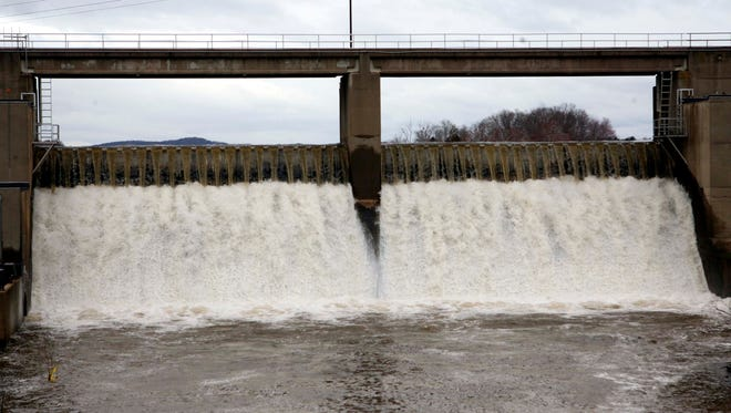Water flows over United Waterâ??s dam by the Lake DeForest reservoir in West Nyack in 2007.