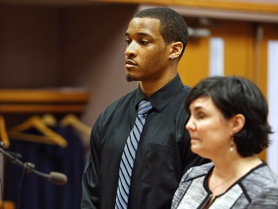 Former Michigan State football player Demetric Vance, left, and his attorney Mary Chartier appear in court, Tuesday, June 6, 2017, in East Lansing, Mich. Vance and two other Michigan State football players were charged Tuesday with criminal sexual conduct in connection with an incident that occurred on campus in January. (Mike Mulholland/The Grand Rapids Press via AP)