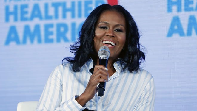 In this May 12, 2017, file photo, former first lady Michelle Obama smiles while speaking at the Partnership for a Healthier American 2017 Healthier Future Summit in Washington.