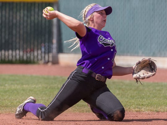 Spanish Springs second baseman Kilee Pender makes the throw to first from her knees in the 4A Softball Championship game at Manogue  on Saturday. The Cougars won, 6-2