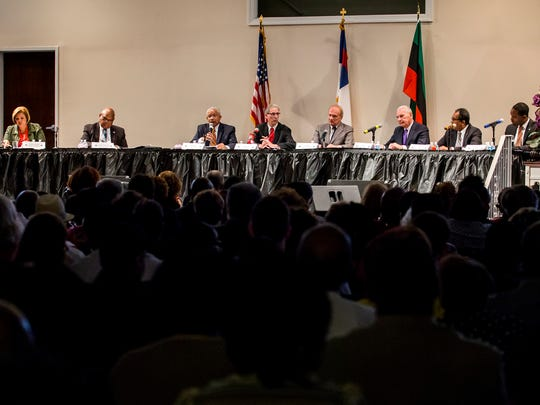Mayoral candidates sit on stage during the Complexities of Color Coalition's Wilmington Mayoral Debate at the Ezion Fair Baptist Church in Wilmington on Monday evening.