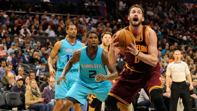 Cavaliers forward Kevin Love drives to the basket during a victory Friday against the Hornets.