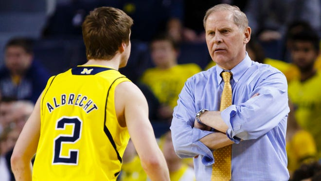 Michigan head coach John Beilein talks to guard Spike Albrecht against Michigan State at Crisler Center on Feb. 17, 2015. Michigan State won 80-67.