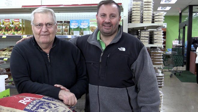 Ali Sater, left, who moved to Metro Detroit from Beirut in 1974, owns International Foods on Dequindre Road in Sterling Heights. His son Sam Sater, right, manages the store.