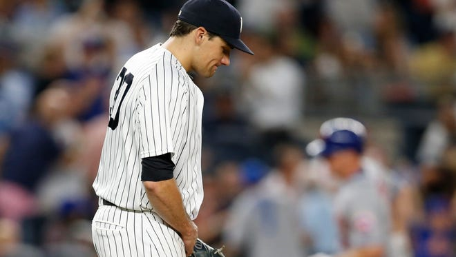 New York Yankees starting pitcher Nathan Eovaldi reacts after allowing a three-run home run to New York Mets' Jay Bruce, rear, during the fifth inning of a baseball game, Thursday, Aug. 4, 2016, in New York.