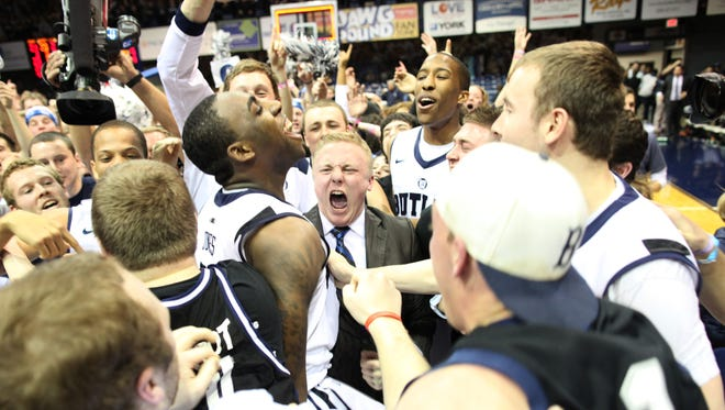 Butler players and fans react after a last second shot by Roosevelt Jones, middle, to win the game against Gonzaga at Hinkle Fieldhouse Saturday January 19, 2013. Butler won 64-63 on a last second shot by Roosevelt Jones. 