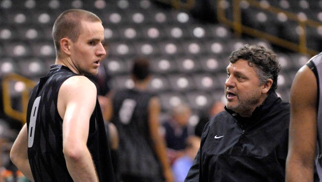 Head coach Greg Kampe, right, talks with Max Hooper(10), during practice.