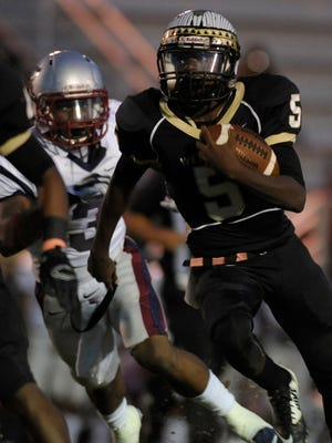 Wetumpka's Rod Thrasher tries to elude Park Crossing's Jaylan Smith on Friday at Hohenberg Field in Wetumpka.