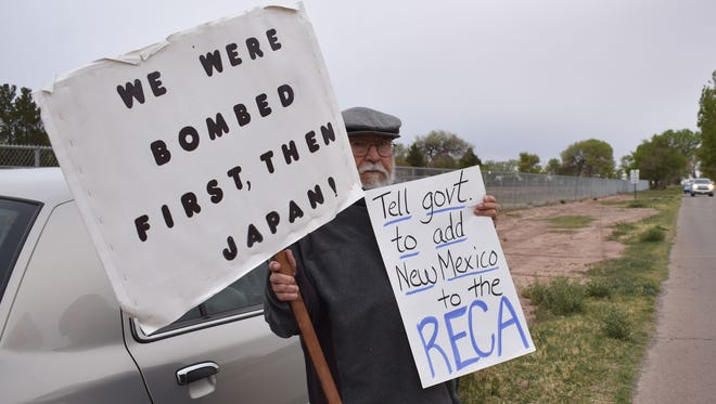 In this file photo, Ernesto Borunda joins the Tularosa Basin Downwinders during their peaceful demonstration in 2017. When the Trinity Site  is opened bi-annually, the Downwinders hold signs informing visitors heading into the Trinity Siteabout their cause.