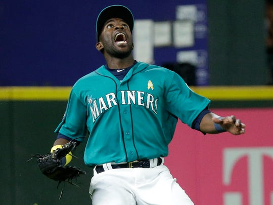 Mariners left fielder Guillermo Heredia calls out a fly ball during the eighth inning of Seattle's 3-2 win on Friday.