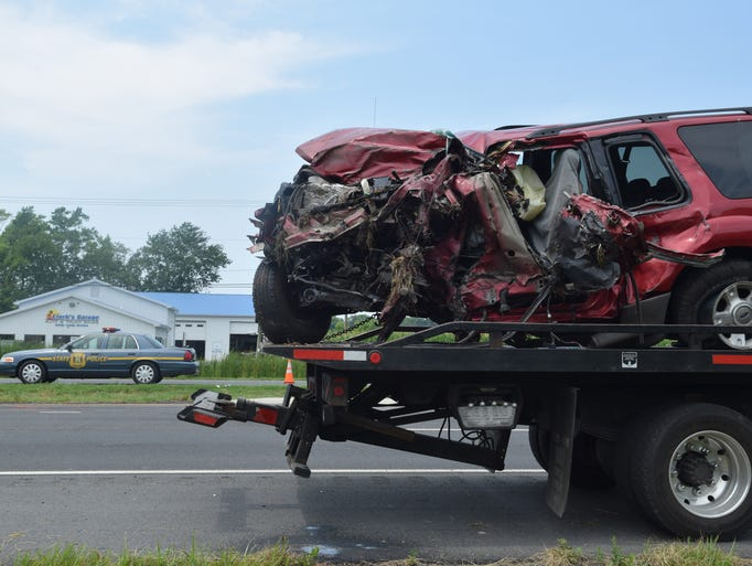 This red Ford Explorer collided with a 10-wheel truck around 10 a.m. July 14.