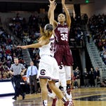 Mississippi State's Victoria Vivians shoots a jumper while defended by South Carolina's Asia Dozier during the first half of an NCAA college basketball game Thursday, Feb. 26, 2015, in Columbia, S.C. (AP Photo/Richard Shiro)