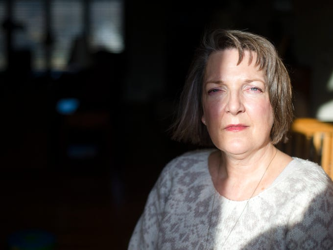 Lori Minor stands for a portrait at her home in Kalona