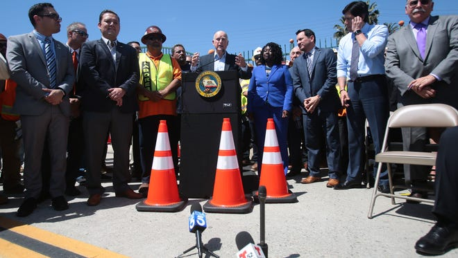 California Governor Jerry Brown speaks in Riverside on Tuesday, April 4, 2017, in support of the Road Repair and Accountability Act or SB 1, a 10 year, $52.4 billion road repair and transportation investment bill.
