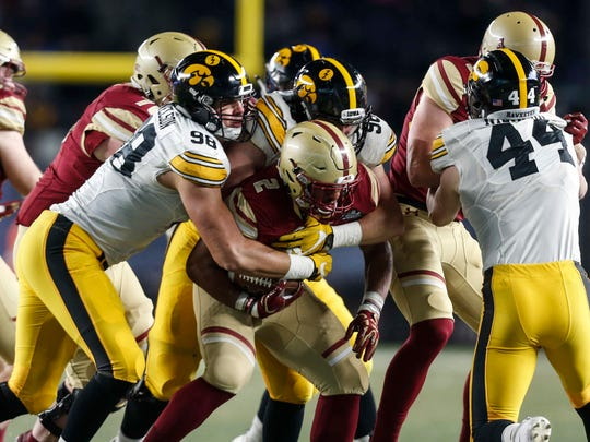 Iowa's Anthony Nelson (98) and Matt Nelson (96) team up to stop Boston College running back AJ Dillon during the 2017 Pinstripe Bowl at Yankee Stadium in Bronx, New York on Wednesday, Dec. 27, 2017.