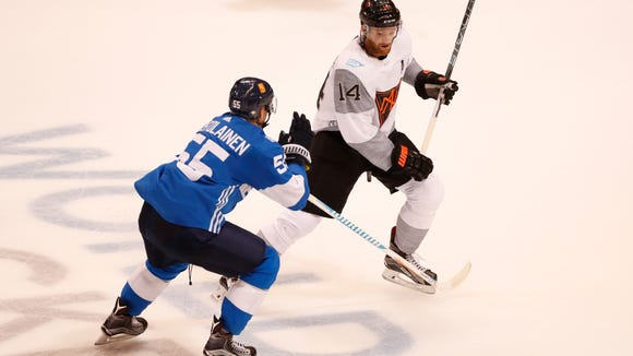 """Sean Couturier, right, feels like he's """"in mid-season form"""" after playing for Team North America in the World Cup."""