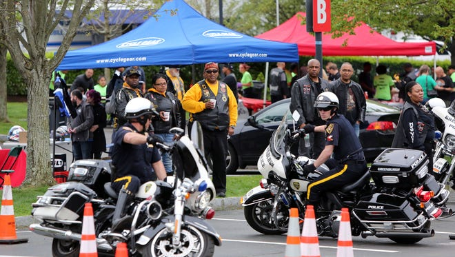 Riders watch Greenburgh police Detective Ed Demelo, left, and Police Officer Peter Schmitt navigate through cones without stopping during a motorcycle safety event in Greenburgh on Sunday.
