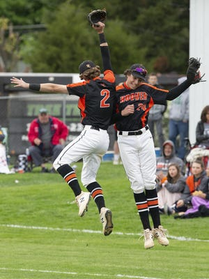 Hoover's Connor Ashby (left) and Owen Blackledge celebrate a double play ending Perry's fourth inning on May 21, 2019.