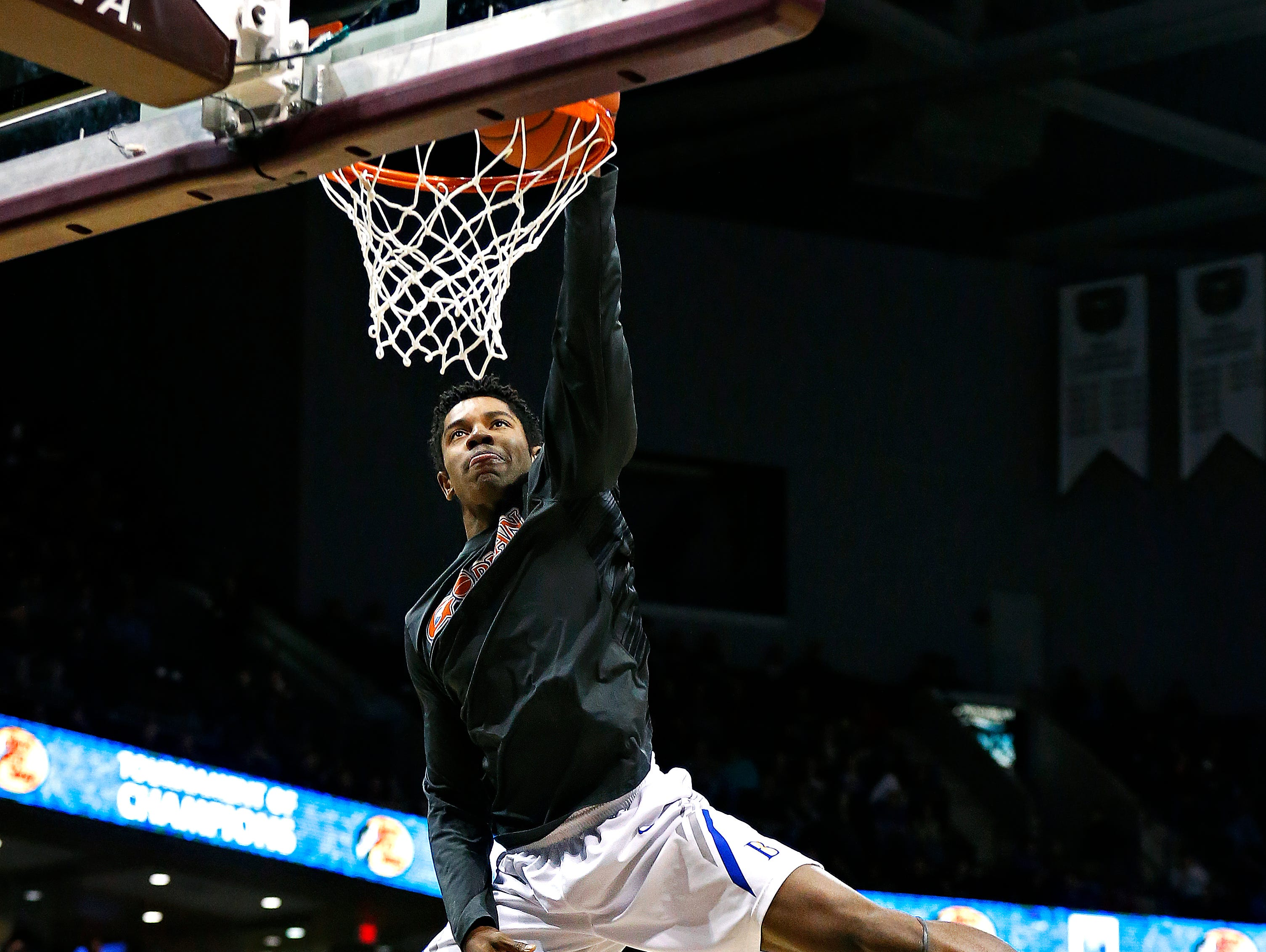 Bishop Gorman High School (Las Vegas, Nev.) guard Christian Popoola Jr. (22) slam dunks during the dunk contest portion of the 2016 Tournament of Champions at JQH Arena in Springfield, Mo. on Jan. 15, 2015. Popoola Jr. won first place in the contest.