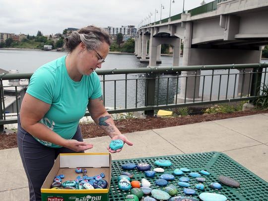 Cathy Tomko, a member of the Kitsap Rocks group, will be placing the painted rocks along the route of Saturday's Bridging Bremerton event.