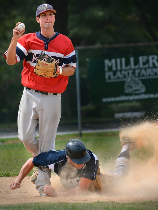 Glen Rock's Brad McCullough slides into Jacobus shortstop Kyle Saxman to break up a double play Sunday in Jacobus. Glen Rock, Central League champion, defeated Jacobus, Susquehanna League champs, 6-1, and captured the best-of-three series 2-0