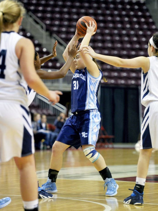 Christian School of York's Kaitlyn Hess looks for an open teammate in the second half of the District 3 Class A championship game Thursday at Giant Center.