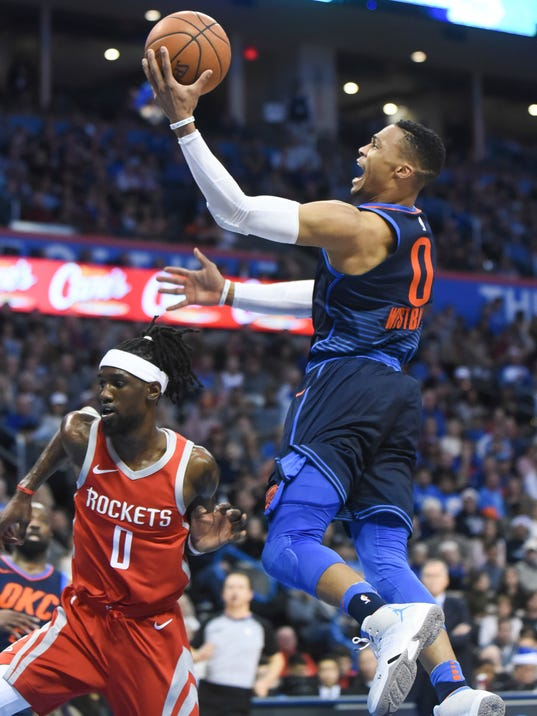 Oklahoma City Thunder's Russell Westbrook goes up for a shot over Houston Rockets' Briante Weber in the second half of an NBA basketball game in Oklahoma City, Monday, Dec. 25, 2017. Oklahoma City won, 112-107. (AP Photo/Kyle Phillips)
