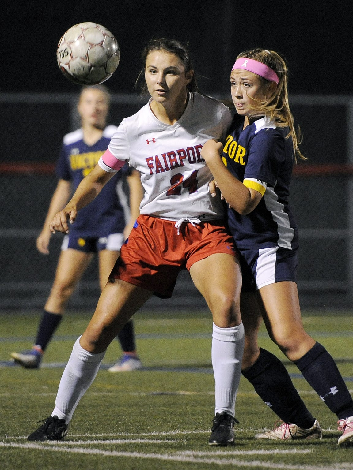 Fairport's Claire Myers, left, and Victor's Emily Leonard