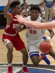 Cape Coral's Harwin Francois drives towards the basket
