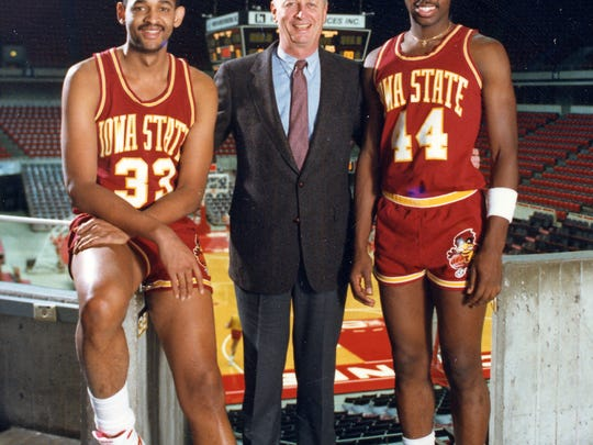 Jeff Grayer, right, poses with former Iowa State head coach Johnny Orr and Grayer's former teammate, Sam Hill.