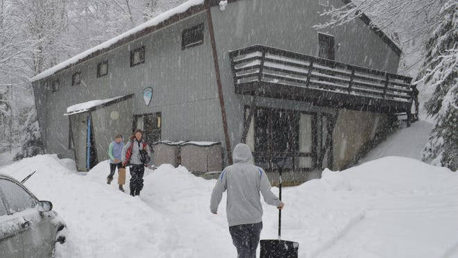 White Plains Ski Club member Leah Dean and her daughter head home in a squall at Mad River Glen in Waitsfield, Vermont.