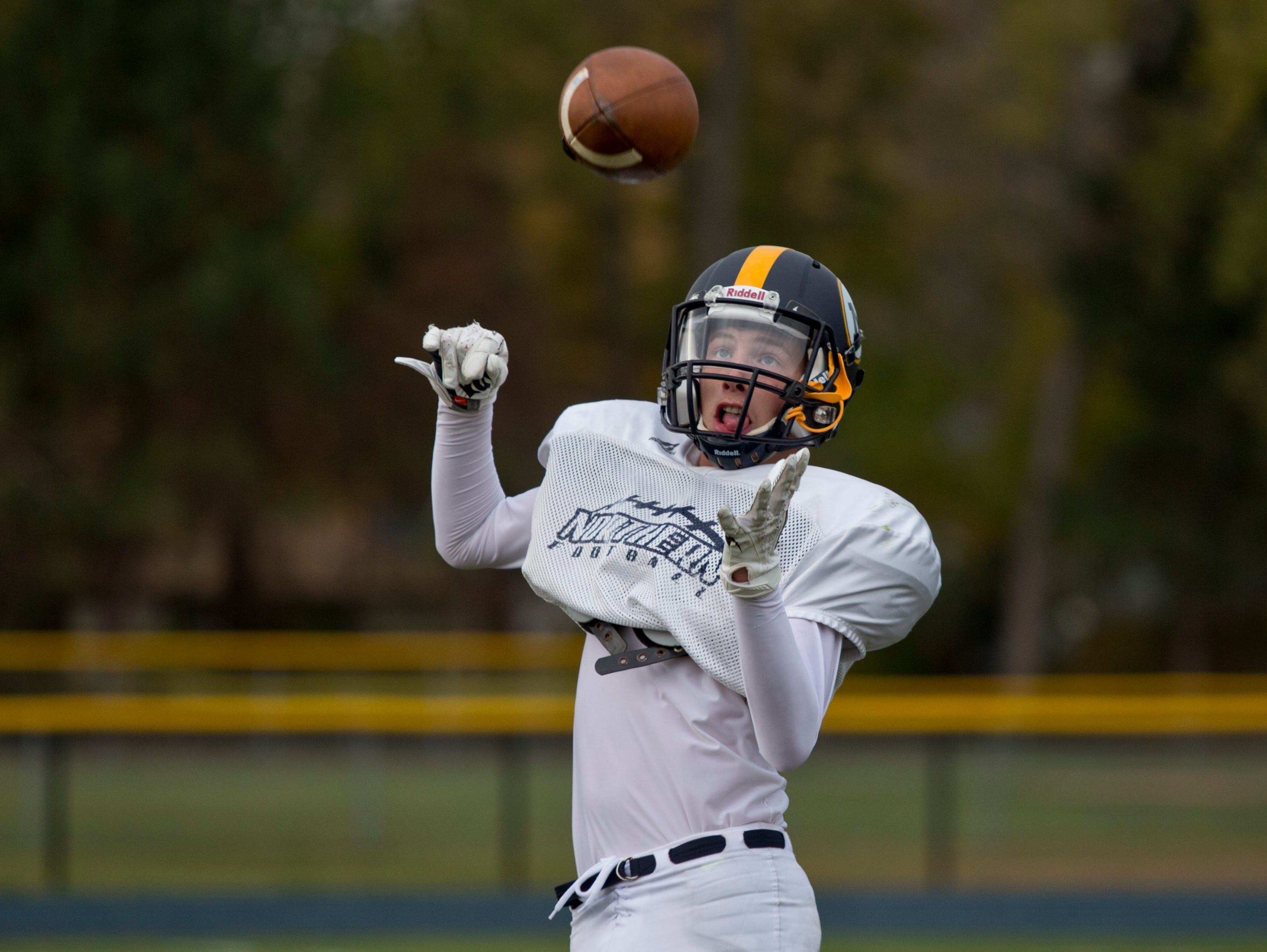 Senior Baily Aldea does a one-arm catch during practice Wednesday, October 21, 2015 at Port Huron Northern High School.