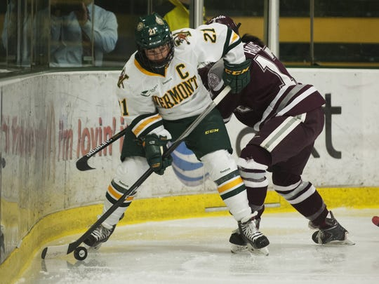 Vermont forward Amanda Pelkey (21) looks to pass the puck during the women's hockey game between the Colgate Raiders and the Vermont Catamounts at Gutterson Fieldhouse on Friday night.