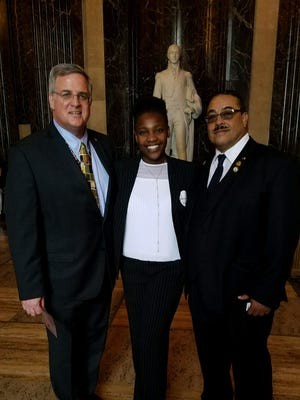 Breayana Bradley, a Tulane student who went through the state's foster care system, and Rep. Kenny Cox, D-Natchitoches, right, posed with state official Chip Coulter after Cox gave Bradley a scholarship.