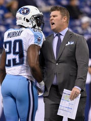 Titans General Manager Jon Robinson talks with Titans running back DeMarco Murray (29) before the start of the game against the Colts at Lucas Oil Stadium Sunday, Nov. 20, 2016, in Indianapolis, Ind.