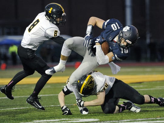 Pittsford's Jared Petrichick (10) takes a hit from
