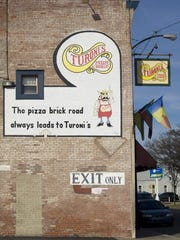 DENNY SIMMONS / COURIER & PRESS   Turoni's Pizzery & Brewery has been serving up pizza in Evansville since 1963 and added their own beers in 1996.