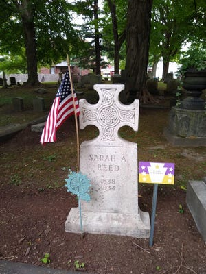 A suffragist marker is shown at the grave of Sarah A. Reed in Erie Cemetery. A new cemetery tour features the graves of more than a dozen leaders in Erie's movement for women's voting rights.