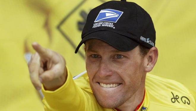 Lance Armstrong, shown in 2003, won the Tour de France seven times but has his titles stripped.
