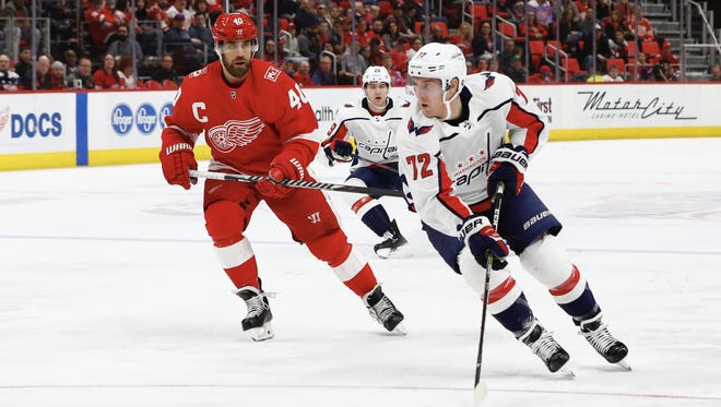 Capitals center Travis Boyd (72) skates with the puck defended by Red Wings center Henrik Zetterberg (40) in the first period on Thursday, March 22, 2018, at Little Caesars Arena.