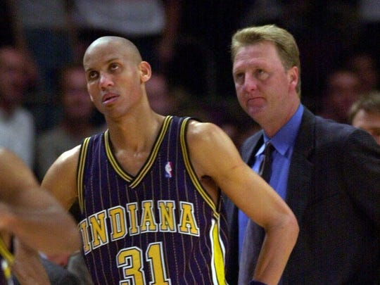 A deflated Reggie Miller and Pacers head coach Larry Bird watch as time runs out in Game 4 of the Eastern Conference finals against the New York Knicks in New York Monday, May 29, 2000.