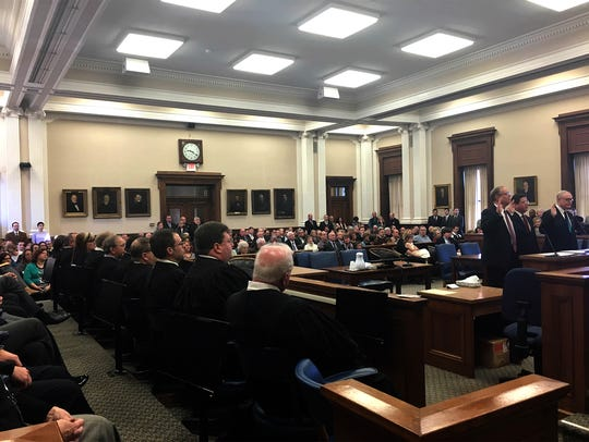 Friends, family and other local officials packed the