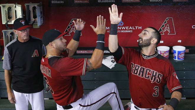 Arizona Diamondbacks' David Peralta (6) and Daniel Descalso (3) go through pre-game rituals before playing against the Los Angeles Dodgers at Chase Field in Phoenix, Ariz. April 23, 2017.