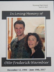 The cover program from Otto Warmbier's funeral at Wyoming High School. The photo shows him and his mom, Cindy. Warmbier, 22, died less then a week after being returned from North Korea in a coma.