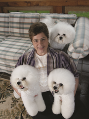 Lorrie Carlton and some of her fluffy white powder puffs.
