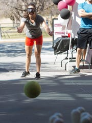 Brittnee Florez, a  senior studying Radiologico Technology, wears a set of drunk goggles that simulate the view of being over the legal limit of alcohol consumption to operate a vehicle, as she attempts to bowl, outside the James B. Dalamater Activities Center, Wednesday, March 15, 2017 at New Mexico State University. The booth was sponsored by Aggies Winning Choice and was being run by students in the public health program to raise awareness of the health issues surrounding binge drinking.